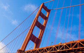 Looking up at the Golden Gate bridge in San Francisco, California
