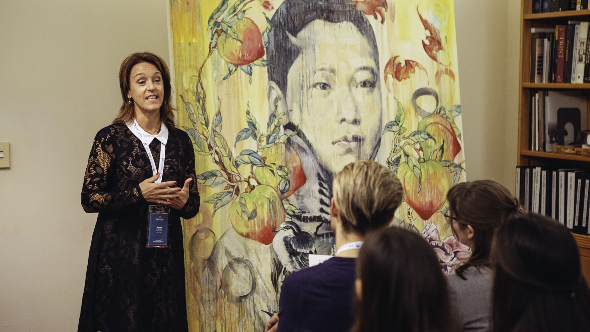 Tonya Turner Carroll '89 speaks with Morehead-Cains at the 2018 Alumni Forum in front of a Hung Liu painting at The Ackland Art Museum in Chapel Hill.