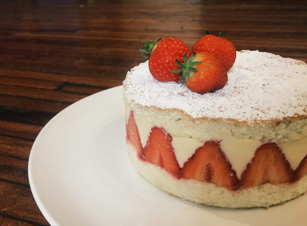 A Fraisier, which includes soft sponge cake, crème mousseline, and strawberries