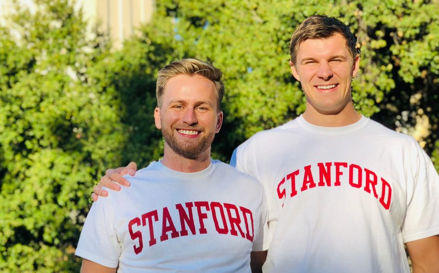 Andrew and Sasha stand together outside on Stanford University's campus.