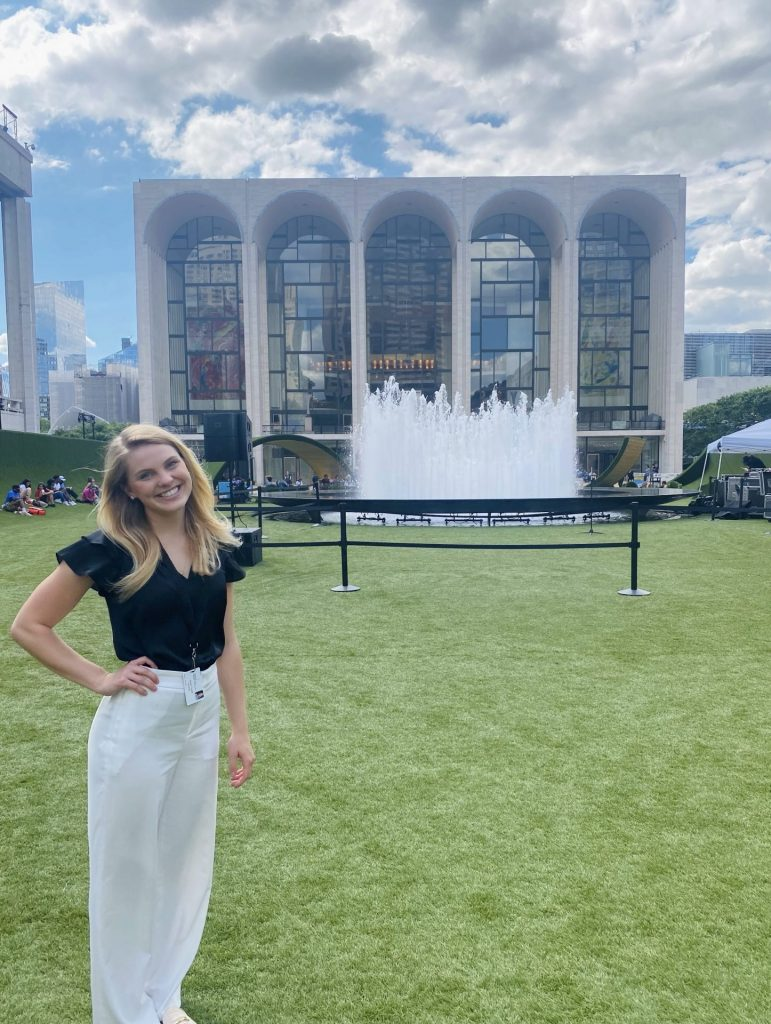 Tatum Trysla '23 stands on The Green, a participatory art installation and Restart Stage in front of the Metropolitan Opera House.