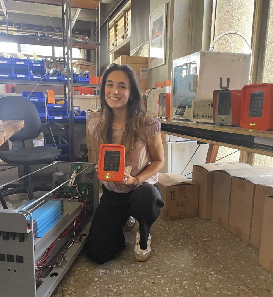 Caroline holds a device used in solar energy services at Kingo Energy.