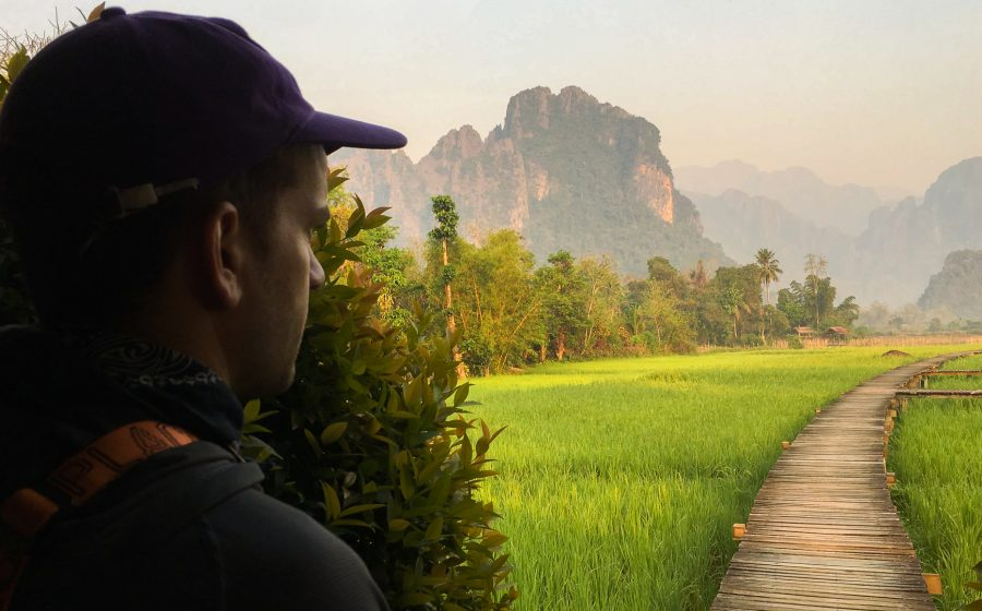 Samuel Haddad looks out across a mountainous landscape in Vientiane, Laos.