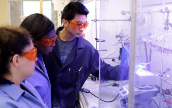 A group of Chancellor's Science Scholars conduct a chemistry experiment in the lab of Dr. David Nicewicz at UNC-Chapel Hill.